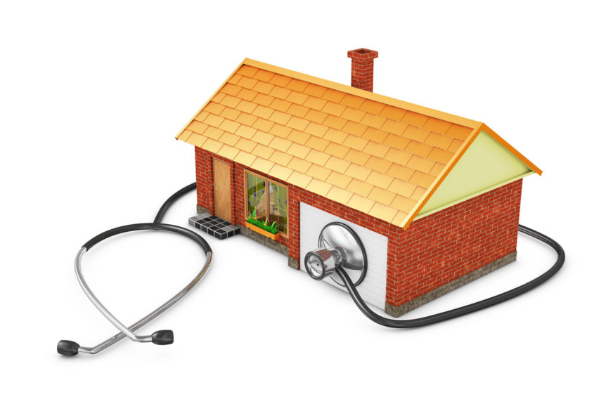 A home on a white background with a stethoscope wrapped around it.